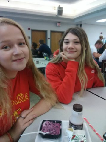 Haley Helm and Emma Ferrell hanging out at lunch